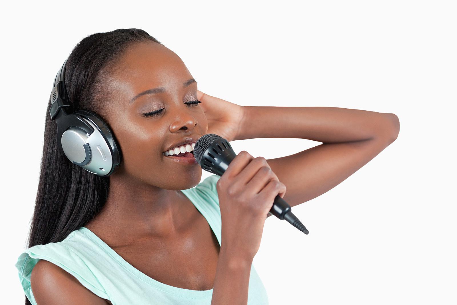Young woman enjoys singing